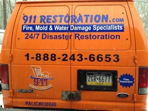 Water Damage Restoration Back Of Van