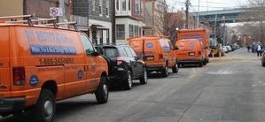 Water Damage and Mold Removal Vans And Trucks At Urban Job Location