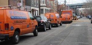 Water Damage Sherrelwood Vans And Trucks At Urban Job Location