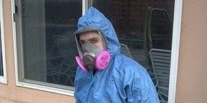 Water Damage Technician In Full Mold Remediation Gear