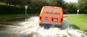 Water Damage Kittredge Van Driving Down Flooded Street