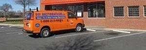 Property Damage Restoration Van Parked At Commercial Job