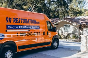 Water-Damage-911Restoration-truck-with-house